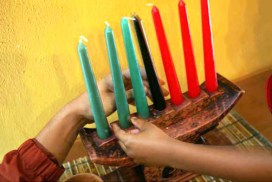 The black candle represents the central Kwanzaa principle of Umoja, meaning Unity, the first day of the week-long Black holiday. – Photo: Eric Luse, SF Chronicle
