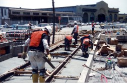 "Liberty Builders' all-Black crew lays light rail track on the Embarcadero in San Francisco – a good example of ""green jobs."" This is the way to put our people to work and improve both our economy and environment. Liberty Builders is owned by Willie Ratcliff, publisher of the Bay View."