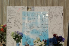 Among the messages at the memorial for Oscar Grant at the Fruitvale BART station where he was executed are: Oscar, we watched you grow up from a lil boy down the street into a man, and O., RIP, peaceful journey, God only pick da best.