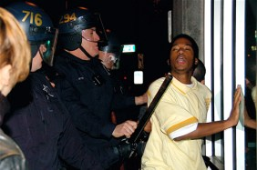 "Oakland's ""finest"" arrest a Black youngster protesting the police execution of Oscar Grant. – Photo: Brooke, IndyBay"