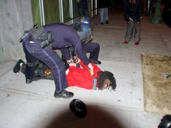 Oakland police arrests on Jan. 7 were unnecessarily brutal. The photographer who took this picture wrote: This guy was walking with a group of friends about a half block past McDonalds on 14th when police targeted just him and chased him in a circle back around the McDonalds. He then ran across the street and once he saw there were cops running at him from both sides, he just stopped and stood there. Cops pushed him down and immediately began tasering him as he lay there not resisting. They may have tasered him for close to a full minute. Since when did using tasers become a standard part of handcuffing someone?  Photo: Dave Id, Indybay