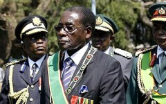 A scandal erupted in December when the U.N. reported that arms were being smuggled to Zimbabwe through DR Congo. Robert Mugabe is shown here with officers of the Zimbabwe National Army.