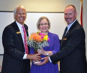 Kris Rider (center) with Dr. Thomas Leitzel and Bryan Derren