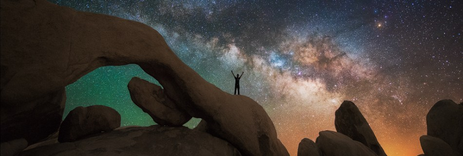 The Milky Way Galaxy over an arch in Joshua Tree National Park.
