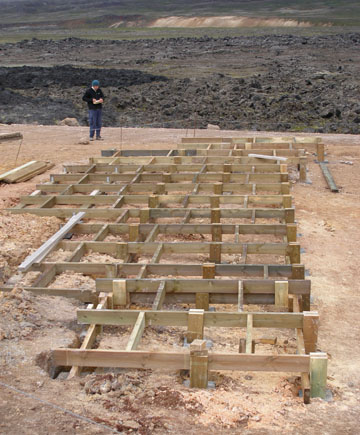 The finished framework had each foot resting on an inset cement pad.