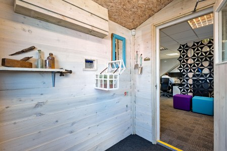 How about an office in a shed - but in a warehouse not a garden?