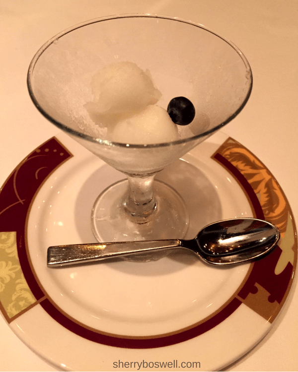 A lemon sorbet cleanses the palate before our entree service.