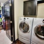 Large laundry room connected to master closet