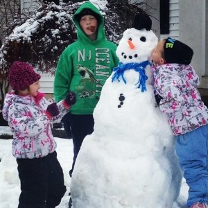 Contestant #2: The artist writes: Our snow man, my son smoking frosty's pipe middle school ugh testing boundaries, my one daughter obsesses with boys she is trying to kiss frosty, my youngest daughter fights with frosty & everyone about anything.