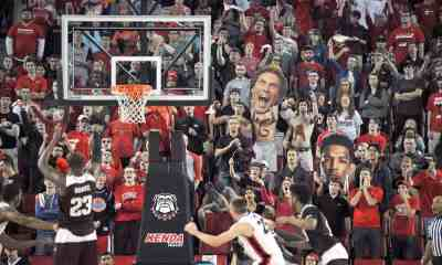 The Georgia student section attempts to distract Texas A&M guard Danuel House (23) at the free throw line. (Photo by Ted Mayer)