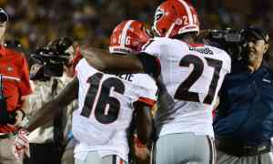 Sep 17, 2016; Columbia, MO, USA; Georgia Bulldogs wide receiver Isaiah McKenzie (16) celebrates with running back Nick Chubb (27) after scoring a touchdown against the Missouri Tigers in the first half at Faurot Field. Mandatory Credit: John Rieger-USA TODAY Sports