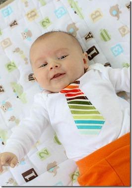 baby in tie onesie