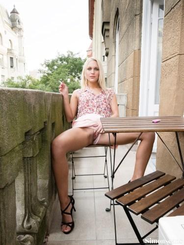 Cecilia smoking on the balcony