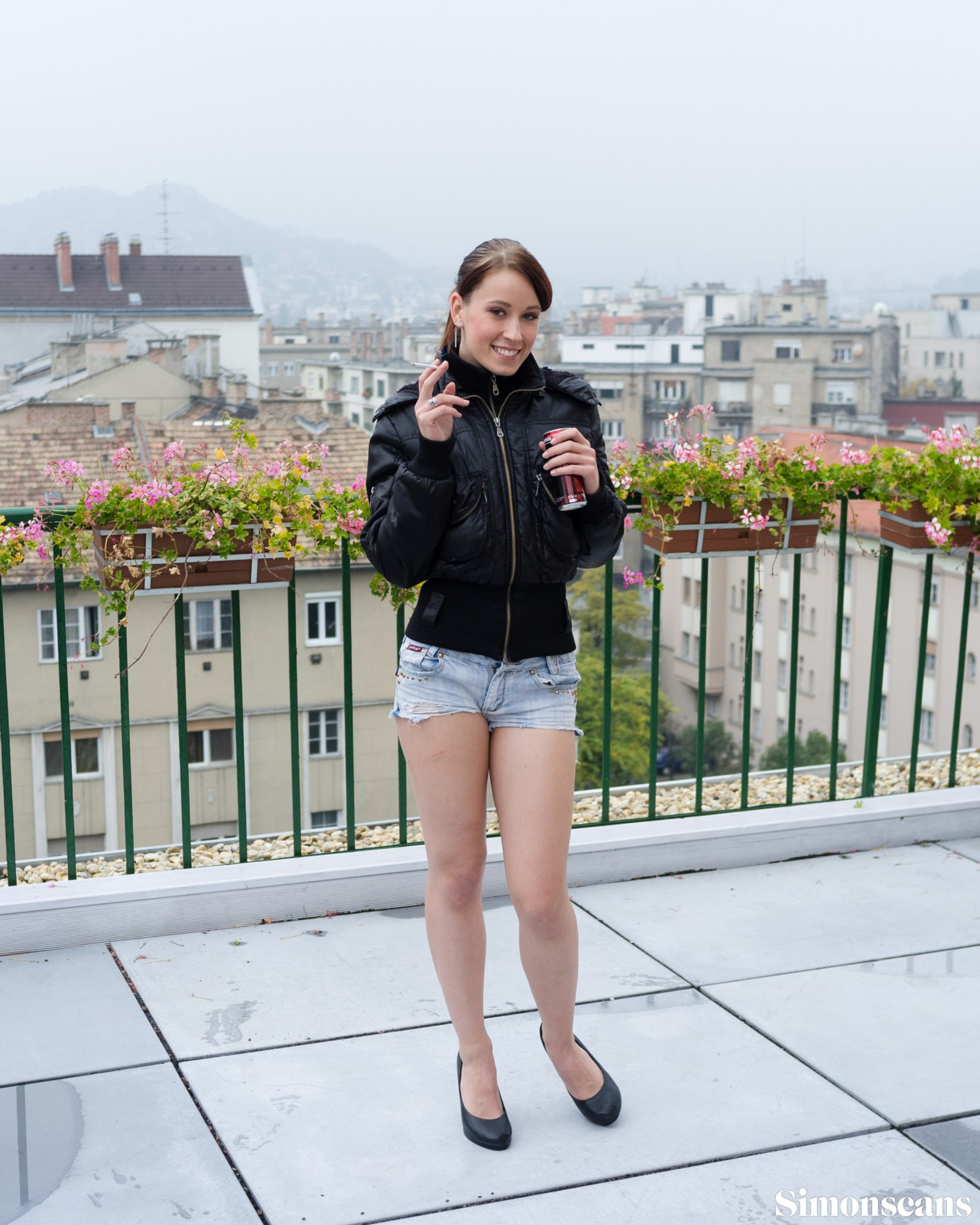 Minnie Manga on the rooftop with an energy drink
