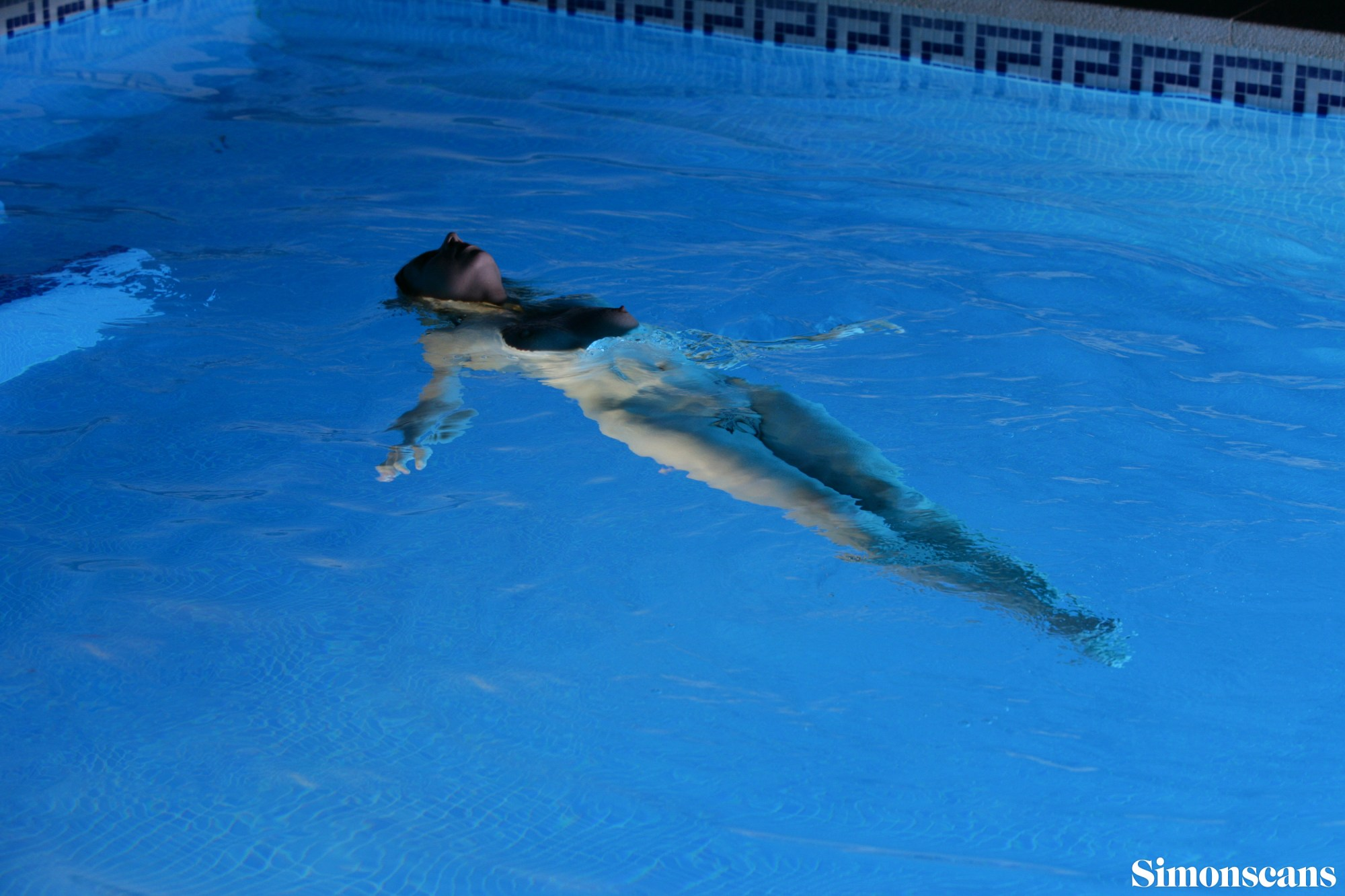 Floating in the pool