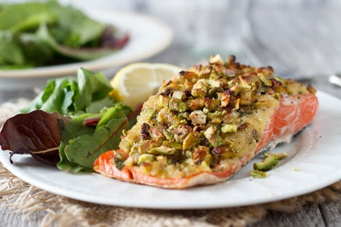 Pistachio Crusted Salmon is a light and healthy meal option you can have on the table in under 30 min. Fresh buttery, rich tasting salmon is topped with a sweet and spicy honey mustard sauce and finished off with a crunchy topping of panko and chopped pistachios.