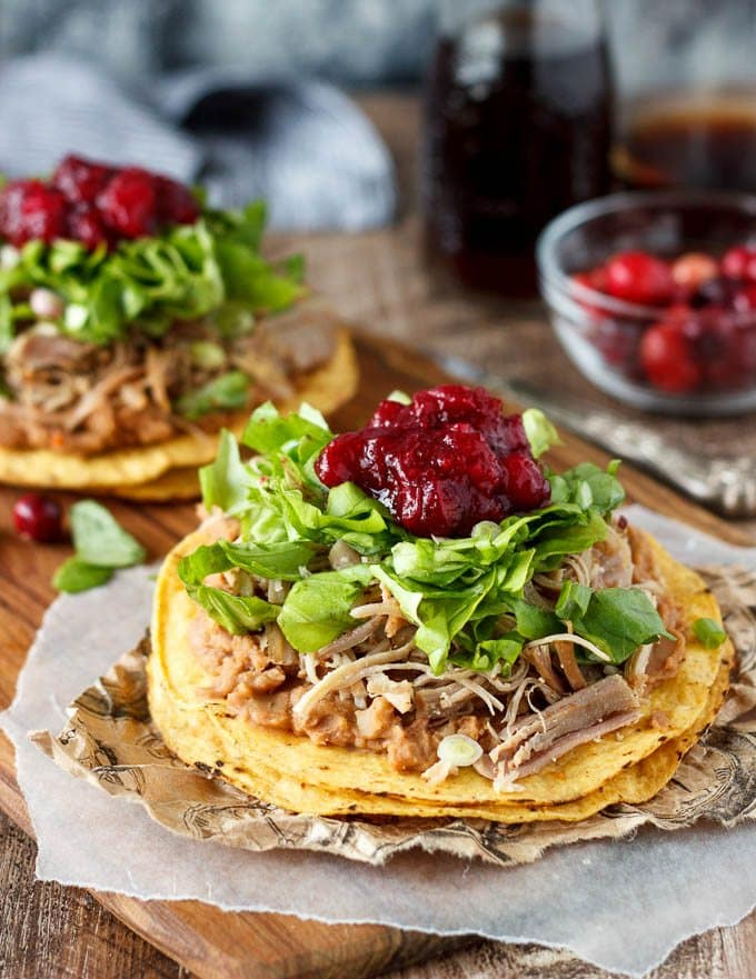 What to do with leftover turkey? Turn it into a quick Mexican meal by adding a punch of southwest chipotle spice and piling it on a tostada with refried beans, lettuce and cranberry sauce