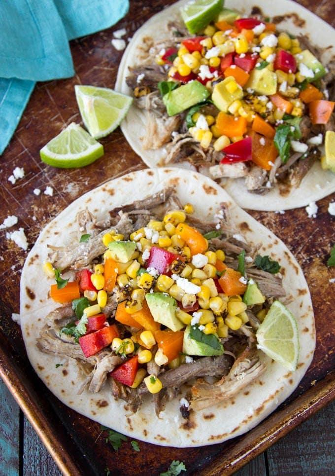slow-cooker -pork-carnitas-tacos-corn-avocado- salsa lime