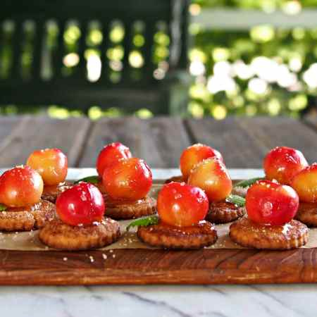 Rainier Cherry Pie Bites -deconstructed cherry pie bites. Sweet, juicy, cinnamon-y, lovely bites made with uncooked cherries & drizzled with almond honey. Simply Sated
