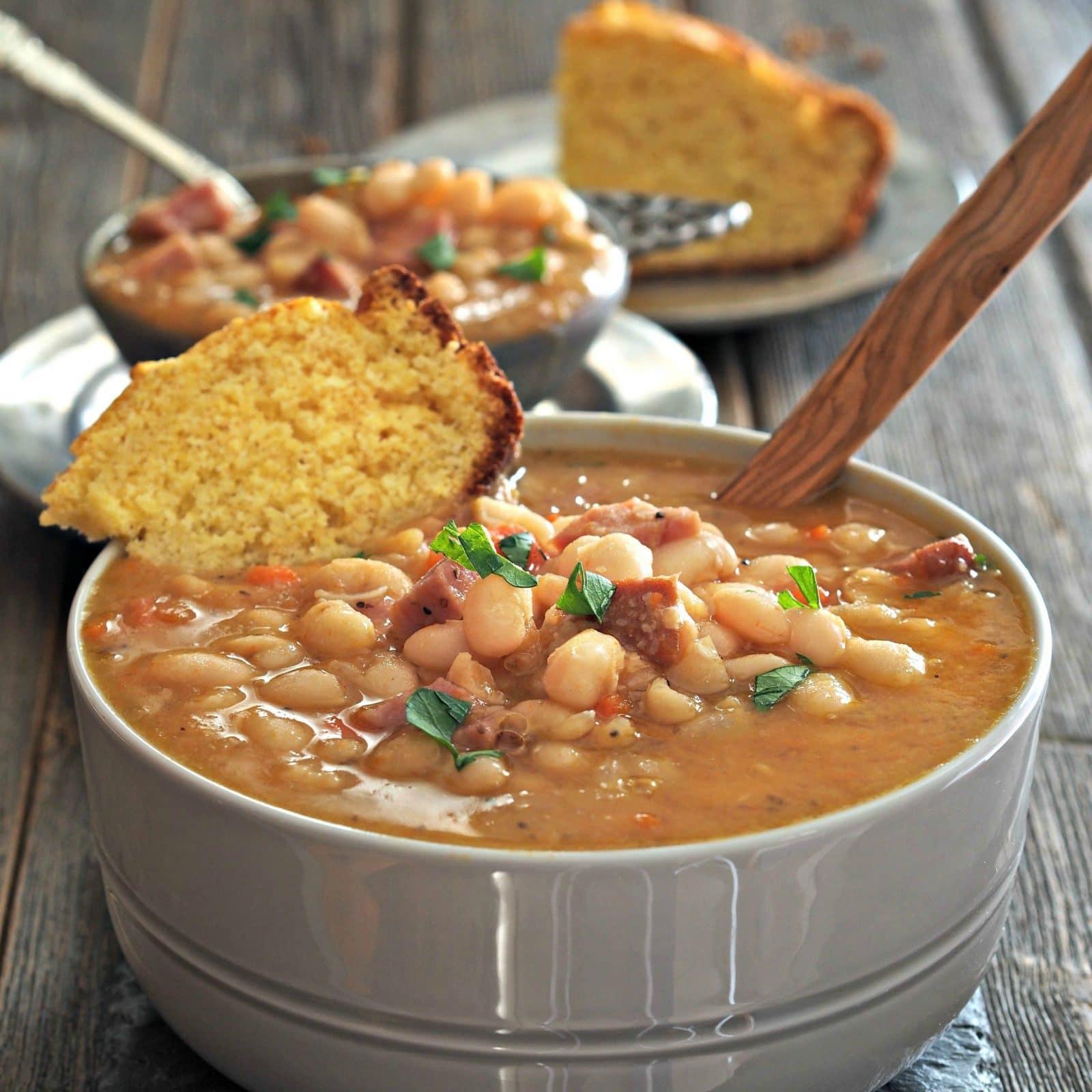 Classic Ham & Bean Soup. White beans & ham simmered w/onions, carrots...