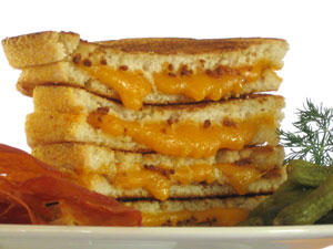 Grilled Cheese Oozing onto the Plate