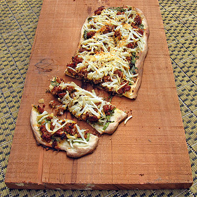 Sausage and Potato Flat Bread with Mustard Greens