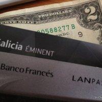 ¿Que valor o fecha del dólar usa la tarjeta de crédito al pagar?