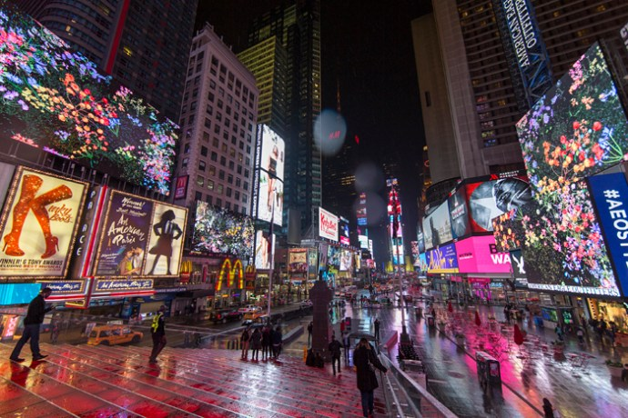 Midnight Moment: Jennifer Steinkamp, Botanic May 1, 2016 - May 30, 2016 every night from 11:57pm-midnight Times Square Arts brings Jennifer Steinkamp's brief film Botanic to Times Square's electronic billboards from 11:57pm to midnight every night in May. This project is a part of Midnight Moment,a monthly presentation by The Times Square Advertising Coalition (TSAC) and Times Square Arts. Botanic is an animation consisting of flowering condolence plants floating inside a cubic framework. The flowers are blown by an unseen force, causing the plants to collide with each other and the edges of the frame. With each collision, they break apart into a collection of seeds, twigs, leaves and petals. The animations loop forward and back, transitioning between breaking apart and coming back together.
