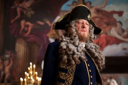 """PIRATES OF THE CARIBBEAN: ON STRANGER TIDES"" Now a privateer in service to the British crown, Hector Barbossa (GEOFFREY RUSH) is now incongruously arrayed in a fine naval uniform and adorned in a powdered wig as befits his new rank."