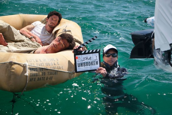 Jack O'Connell, Finn Wittrock, and safety diver Carla Thexton on Unbroken set
