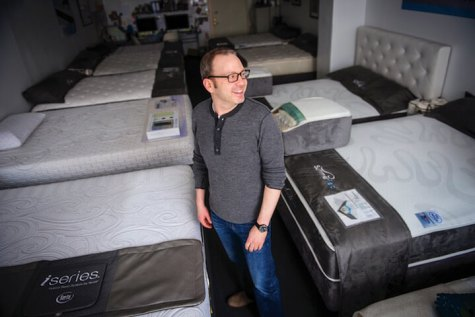 Craig Fruchtman, owner of Craig's Beds, smiles from his 1,100-square-foot shop in New York's Garment District.