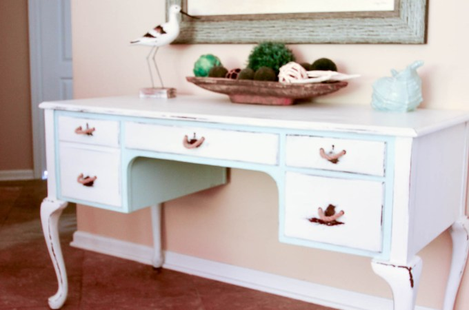 This desk received a coastal makeover with rope handles and two-tonw paint treatment from Slightly Coastal