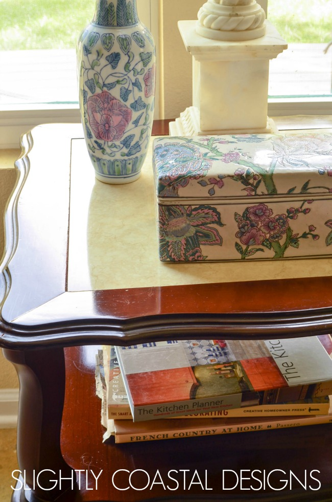 The before photo of a French Country Chalk Painted table. Visit the slightly coastal blog to see the full makeover.