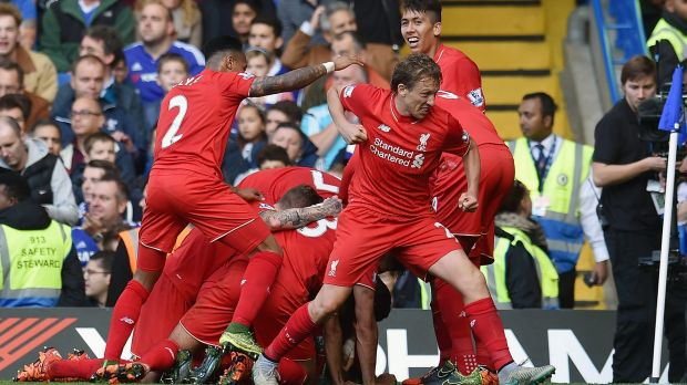 Double delight: Phillipe Coutinho is mobbed after scoring his second goal.