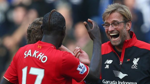 The new special one: Jurgen Klopp celebrates with Mamadou Sakho.