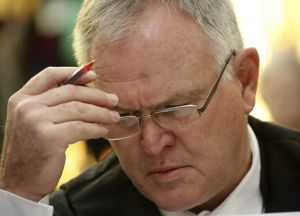 Pistorius' defence lawyer Barry Roux waits before the Supreme Court  hearing gets under way.