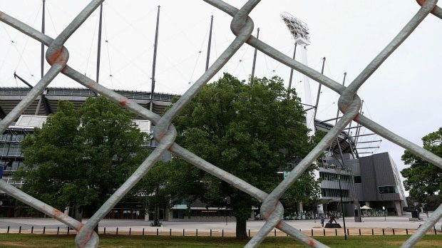 Ring of steel: The fence surrounding the MCG last summer.