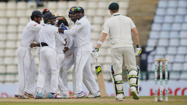 Sri Lankan team members celebrate the dismissal of Australia's Steve Smith on day five.