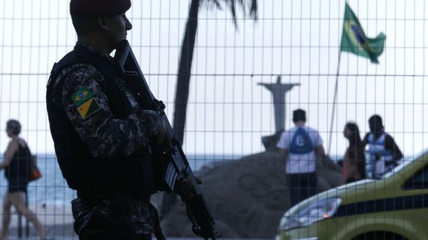 All eyes on Rio: A Brazilian National Force soldier keeps watch along Copacabana beach.