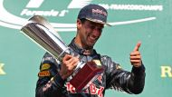 Daniel Ricciardo celebrates on the podium after the Belgium GP.