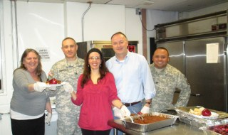 Helping out during the dinner were from left to right Kristine Kossegi Lehn, Chief Network Officer at LI Cares, US Army Captain Robert Cornicelli, Laura Lynn Iacono of LI Cares, Suffolk Legislator Robert Trotta and Sergeant First Class Allan Fajardo.