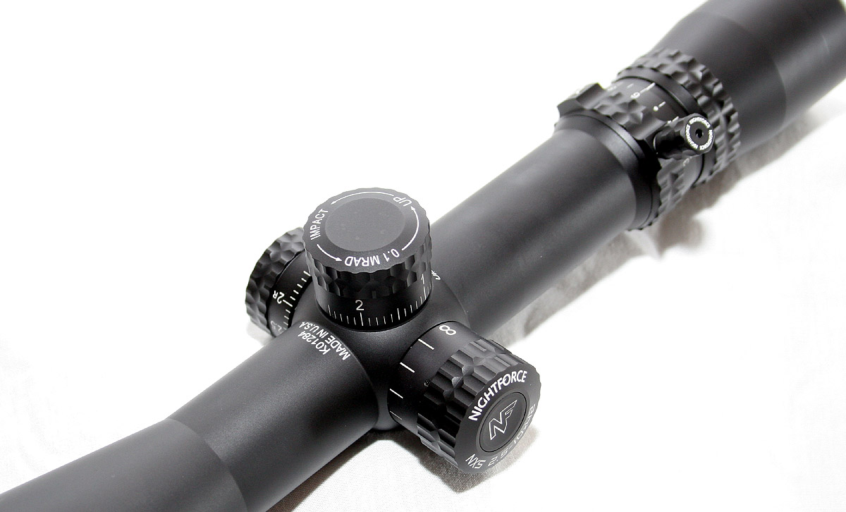 nightforce nxs 2 5 10x42mm compact sniper central on the opposite side of the scope from the windage knob is the side focus knob which is a bit taller than both the elevation and windage knobs