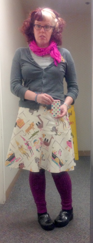 Awesome zoo print skirt worn with magenta pompom scarf from work sample sale, grey cardigan from Gap and grey t-shirt of unknown origin, tights and handknit raspberry legwarmers, pattern from Tiny Owl Knits. Shoes are Dankso clogs. Bamboo squirrel pin from DecoyLab.