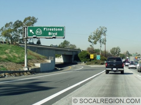 Northbound left exit for Firestone Blvd, former SR-42. This was near where I-105 was planned to end. Firestone Blvd also carried US 101 Bypass, until the construction of the Santa Ana Freeway through here in 1953.