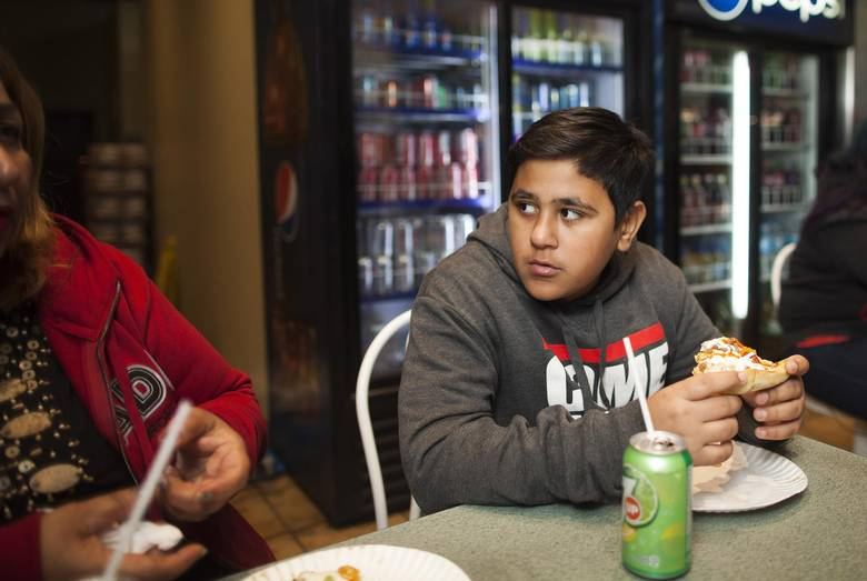 Thirteen-year-old Mike Mohammed chats with his mother, Jamela, over pizza. RAFAL GERSZAK FOR THE GLOBE AND MAIL