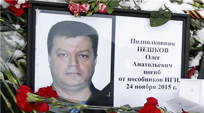 Body of downed Russian pilot back in Russia