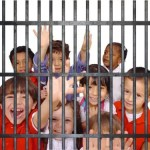 Kids behind Jail Cell Bars 150x150 Les Miserables Cast Performs Live at the Oscars