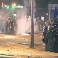 Police fire tear gas in Ferguson Missouri