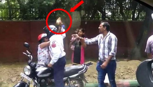 Delhi Police Officer Caught On Camera Hitting A Woman With A Brick. Why? Because She Refused To Bribe