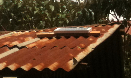 a solar panel on a Kenyan roof